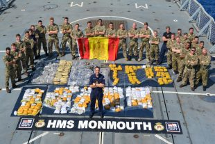 Royal Navy frigate HMS Monmouth has seized £65m of cannabis and heroin from a suspect vessel in the Indian Ocean, dealing a major blow to the funding of terrorism.