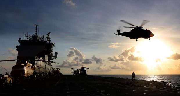 After HMS Ocean's arrival in the Caribbean, Wildcat and Merlin Mk 3 Helicopters from 845 and 847 Naval Air Squadron, of the Commando Helicopter Force (CHF) conduct deck landing and winching practice. Crown copyright.