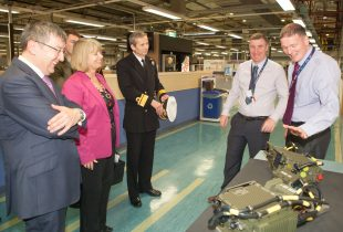 Defence Procurement Minister, Harriett Baldwin (Centre-left), meeting Thales staff at their Glasgow site in Scotland.  An innovative firm of Glaswegian engineers are celebrating 100 years of being the sole periscope and optronics mast supplier to the Royal Navy's submarines.