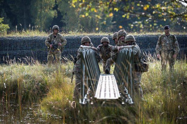 Reserve Engineers from 75 Engineer Regiment get to work building bridges in Germany.