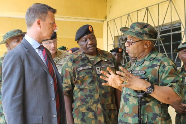 Senior officers from the Nigeria School of Military Engineering brief Mark Lancaster TD MP, on their operations. The minister was visiting UK troops training Nigerian soldiers in bomb scene management and response to terrorist attacks.