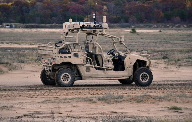 An all-terrain 4x4 vehicle, Polaris MRZR, controlled with an Xbox-style controller. Crown Copyright.