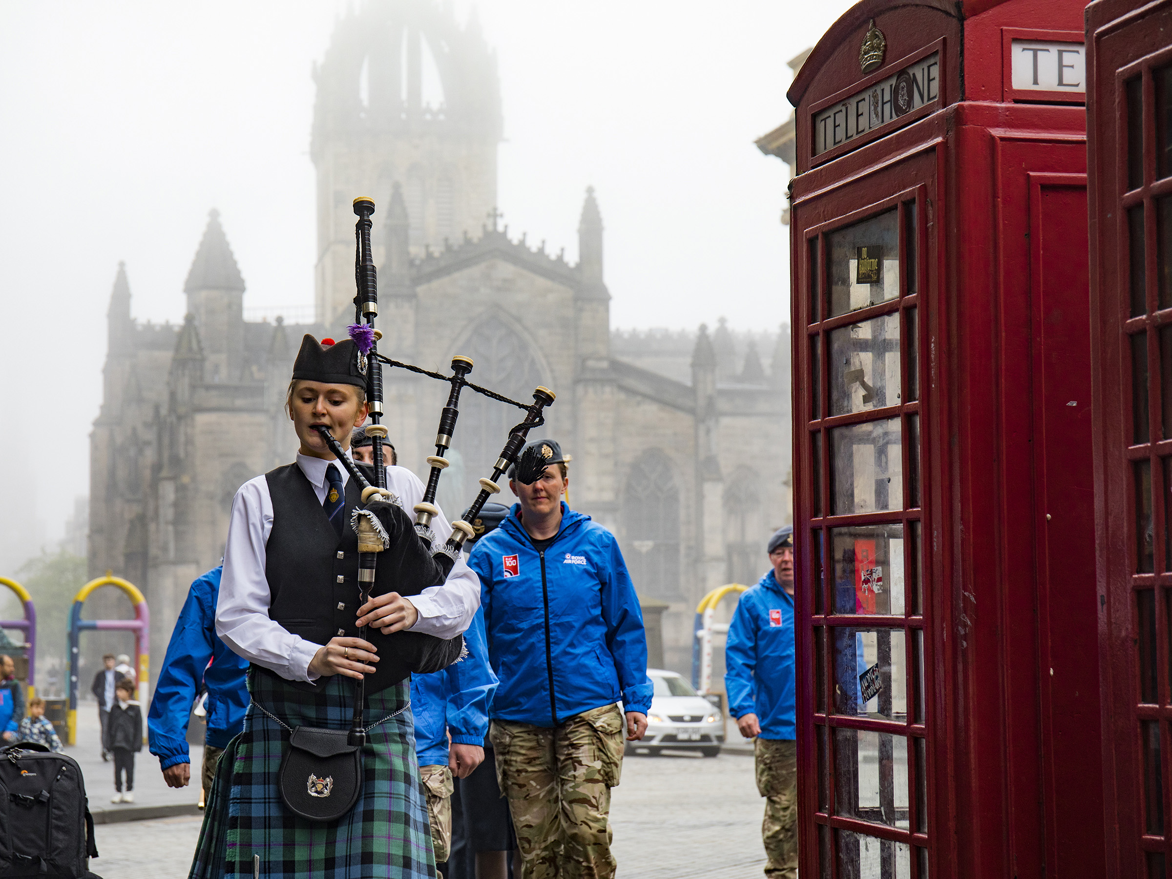 A Legion Scotland piper leads the procession up the Royal Mile. Crown copyright.