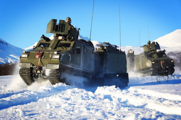 Pictured are Viking Vehicles move through deep snow around Bardufoss exercise areas during Ex Cold Enabler 2018 in Norway.