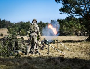 British Army Soldiers from 1st Battalion The Princess of Wales's Royal Regiment (1 PWRR), known as the Tigers, train new Mortar teams on a two-week exercise. A mortar round is visible in flight.