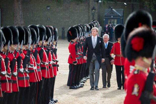 His Majesty King Willem-Alexander of the Netherlands and His Royal Highness Prince Charles, Prince of Wales inspecting 1st Battalion Coldstream Guards during the first day of the Dutch State visit.