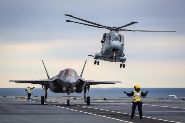 A revolutionary method of landing an F-35 jet on a ship has been carried out for the first time on board HMS Queen Elizabeth. Crown copyright.