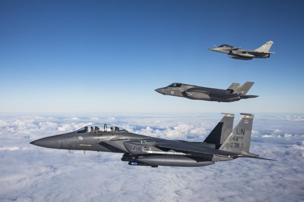 A USAF F-15E Strike Eagle, RAF F-35B Lightning and Armee de l'air Rafale stack up over the North Sea. Crown copyright.