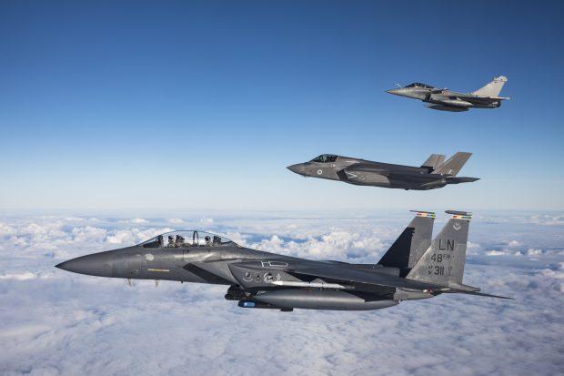 A USAF F-15E Strike Eagle, RAF F-35B Lightning and Armee de l'air Rafale flying in formation