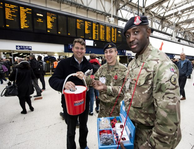 Army personnel selling poppies