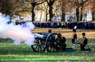 Soldiers fire cannons in a 41 gun salute