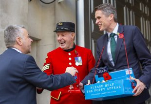 Defence Secretary Gavin Williamson yesterday joined Chelsea Pensioners Anthony Hunt and June Lowe to collect donations for The Royal British Legion's Poppy Appeal in Westminster. Crown Copyright.