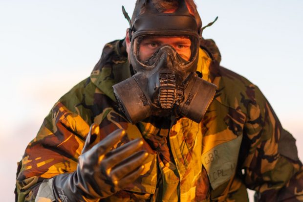 A soldier from 10 Signal Regiment carries out CBRN (Chemical Biological Radiological & Nuclear) training while exercising on the Barry Buddon Training Area in Scotland.