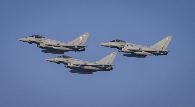 Image shows the RAF Typhoons participating in this years Qatar National Day Airshow, as they transit across Doha bay.