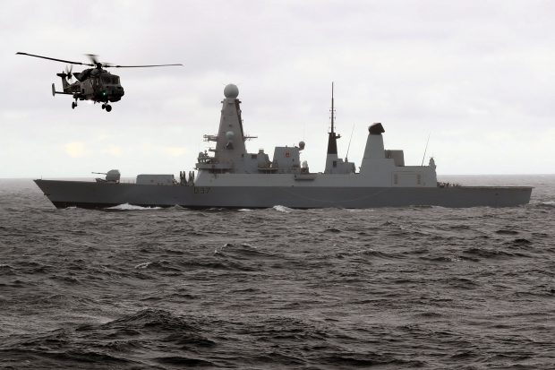 HMS Duncan with a Wildcat helicopter. Crown copyright.