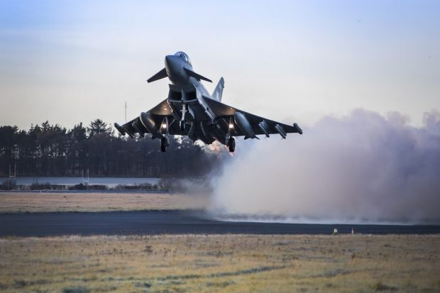 An RAF Lossiemouth Typhoon fighter jet takes off equipped with Meteor missiles.