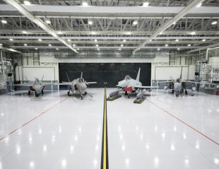 "Image (L-R) of the UK's concept model for the next generation jet fighter ""Tempest"", F-35B, Typhoon and Tornado aircraft, all seen here in the new F-35B hanger at RAF Marham."
