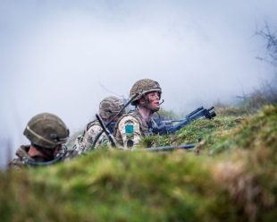 Paratroopers training on a grassy hill