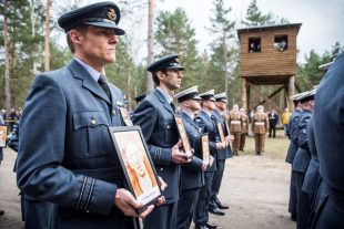 Royal Air Force personnel parading at the site of the Great Escape