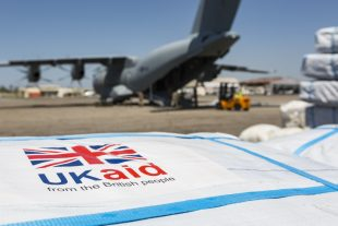 An RAF A400M Atlas aircraft offloading aid packages.