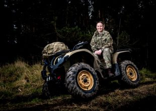A female reservist on a quad bike