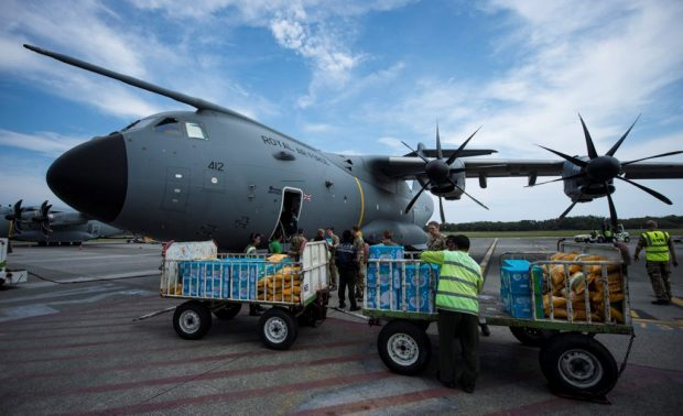 An RAF A400M aircraft is loaded with aid