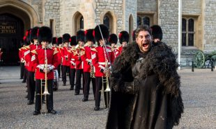 A Game of Thrones actor in front of the Coldstream Guards Band