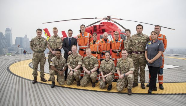 Defence Secretary Gavin Williamson stands alongside staff on the helipad at the Royal London Hospital and London's Air Ambulance at Barts Health NHS Trust. Crown Copyright.