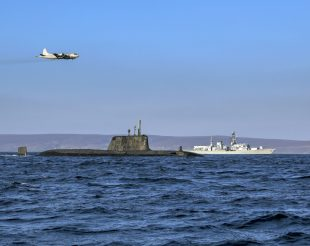 An Astute class nuclear submarine, the Type 23 frigate HMS Kent and a German Navy P3 maritime patrol aircraft at sea.