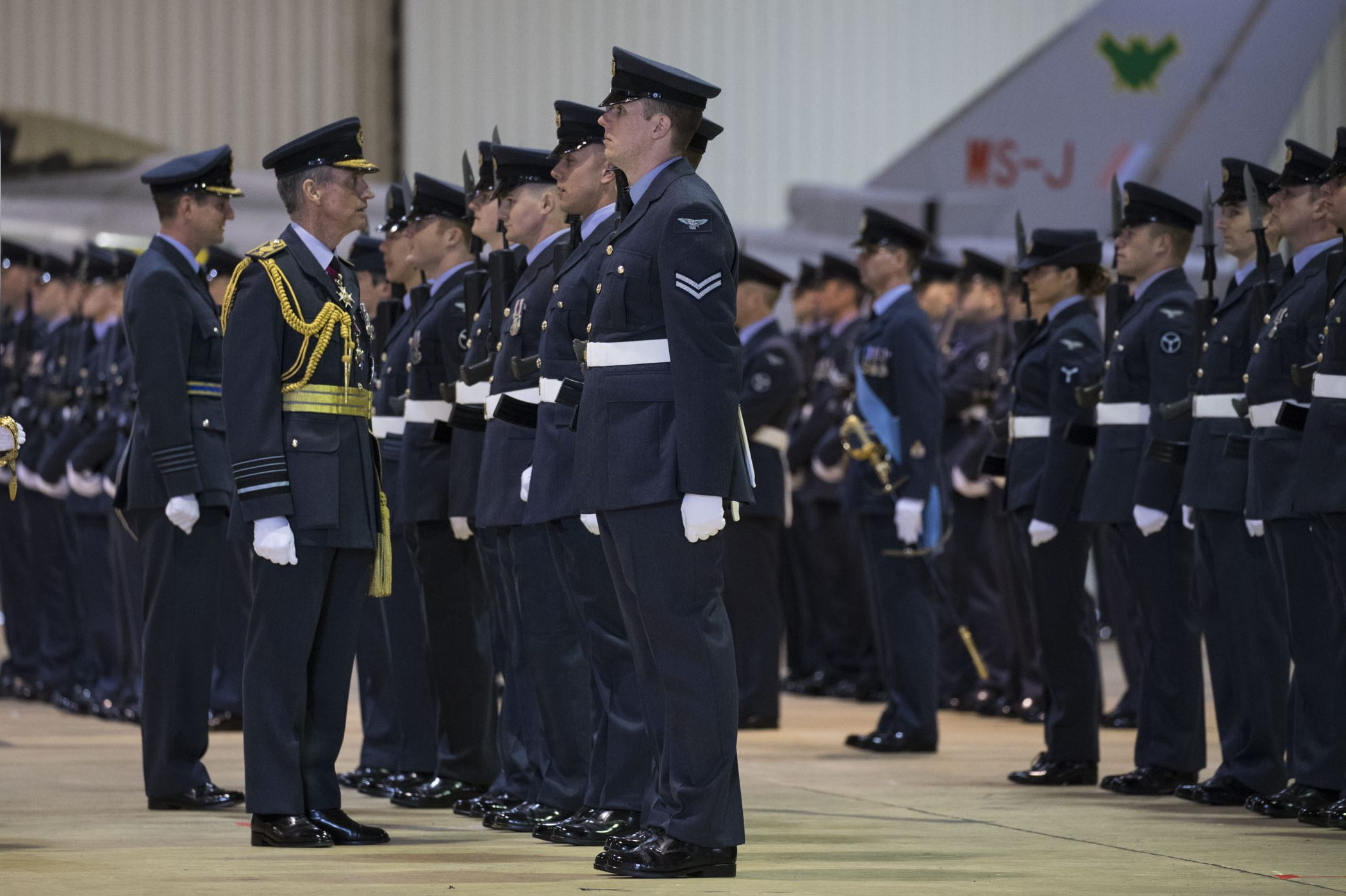 Chief of the Air Staff inspects RAF personnel in a hangar in RAF Lossiemouth
