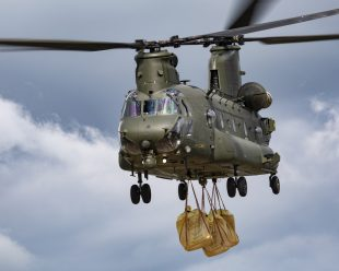 An RAF Chinook carrying bags of rubble to help flood defences