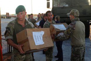 Royal Marines delivering boxes of aid