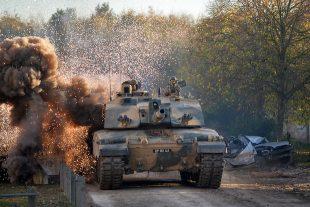 A tank crossing a bridge