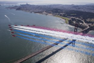 The Royal Air Force Aerobatic Team, The Red Arrows flypast the Golden Gate Bridge, San Francisco, yesterday, trailing the Red, White and blue smoke over the bridge.